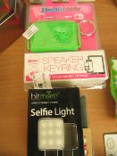 4x Various items such as a selfie light, music player and more.