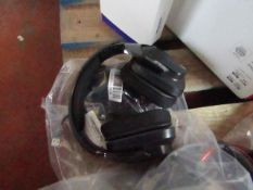 Logitech over-ear gaming headphones, untested.