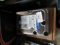 Western Digital 2TB hard drive, untested.