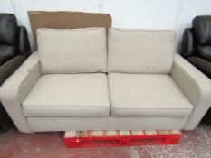 Beige fabric 2 seater sofa bed, in good condition but has a few dirty parts from storage, should