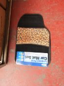 Set of 4 leopard print car mats, new and packaged.