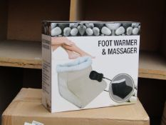 Foot warmer and massager, new and boxed.