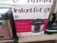 Instant Pot 9 in 1 5.7L multi-use pressure cooker, powers on but not tested full functions and
