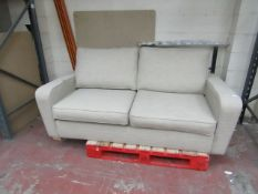 Beige Costco 2 seater pull out sofa bed, in good condition but has a couple of dirt marks on that