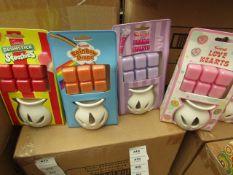 4x Various Swizzels scented wax burners, 1x Drumstick Squashies, 1x Parma Violets, 1x Rainbow