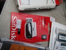 SanDisk 16GB USB flash drive, unchecked and packaged.