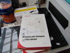 Honeywell wireless pet immune motion sensor, unchecked and boxed.