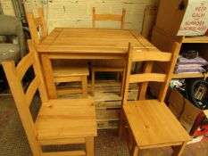 Wooden dining Table with 4 Matching Chairs. Unused with No major Damage. Comes with Fixings but