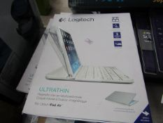 Logitech Iltrathin Magnetic clip on keyboard cover for iPad airs, boxed and unchecked