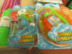 5 Items Being 3 x Giant bubble Kits,1L Bottle of Bubbles & a Bubble Gum. All unused