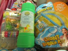 4 Items Being Bubble Guns. Unused & Packaged