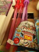 5 Items Being 4 Bubble Wands a Smashers collector tin. All unused