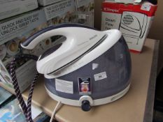 Philips Easy De Calc steam generator iron, powers on for heat and in used condition. We have not