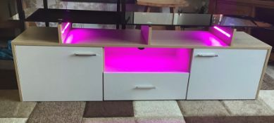 White and oak Melamine TV unit with 9 colour LED lighting, brand new and boxed. RRP Circa £160.00