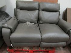 Grey leather Power reclining 2 seater sofa, tested working, has a bit of damage to the back corner