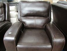 Costco power reclining armchair, untested and no major damage.