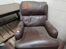 Costco Brown leather swivel reclining armchair, needs a patch recolouring on the head rest.
