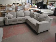 Costco corner sofa with button arms, in used condition and has stains.
