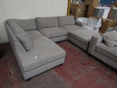 Costco corner sofa with button base, in used condition.