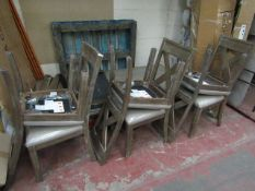 A Bayside extending dining table with 6 dining chair the chair still have protective plastic on