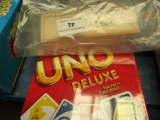 2x Various Games - 1x Uno Deluxe - Packaged. 1x Wooden Domino - Packaged.