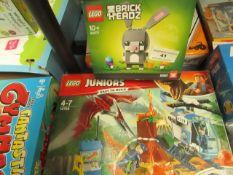 2x Lego Items Being: 1x Lego - Brick Headz Bunny - Boxed. 1x Lego Jurassic World - Juniors - Boxed.