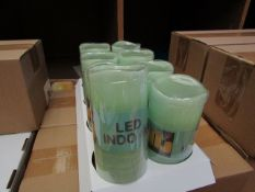 8 x Indoor Battery Operated LED Candles with 4hr or 8hr auto options new & packaged (batteries not
