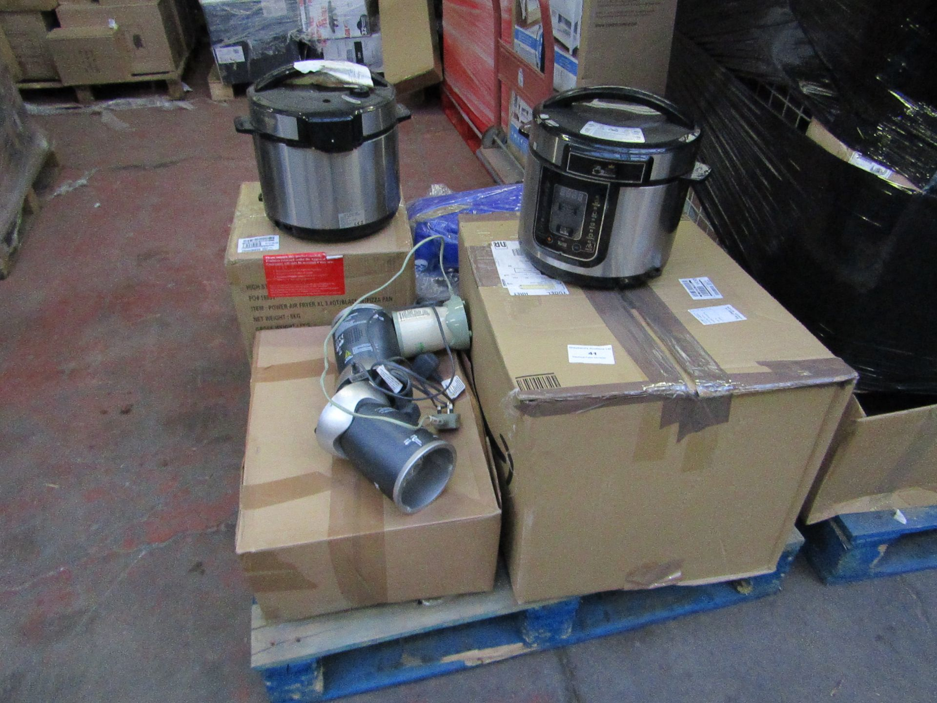 Small pallet of uncollected raw customer return electricals.