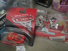 2 Items Being a Cars Lightning Mcqueen Car & a Transformers Skysledge Stormhammer Figure. Both new &