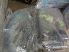 2 Items Being Untamed Stealth Raptor Figure & a Black Manta Figure. Packaging is damaged but have