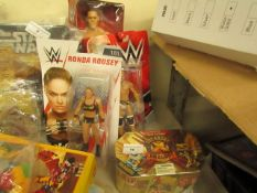 4 Items Being 3 x Wrestling Figures & a Treasure Dragons Gols (sealed). Packaging slightly damaged