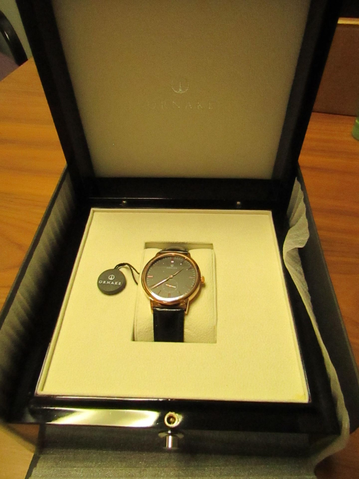 Ornake watch, miyota movement, black and gold with black leather strap, new, Boxed and ticking.