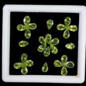 Natural Peridot - 22.95 carats - 26 pieces - average retail value £ 5,581.14