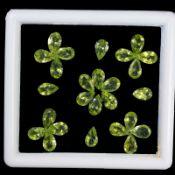 Natural Peridot - 22.95 carats - 26 pieces - average retail value £ 5,581.14