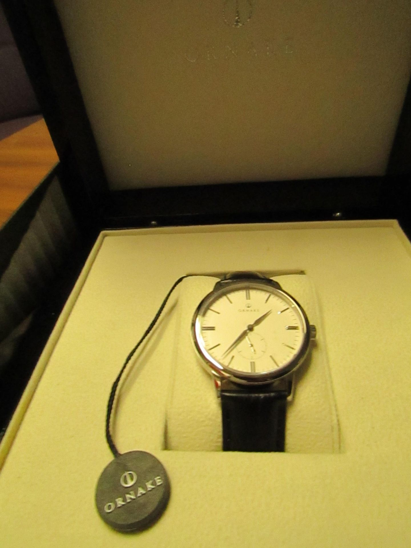 Ornake watch, miyota movement, white and silver with black leather strap, new, Boxed and ticking.