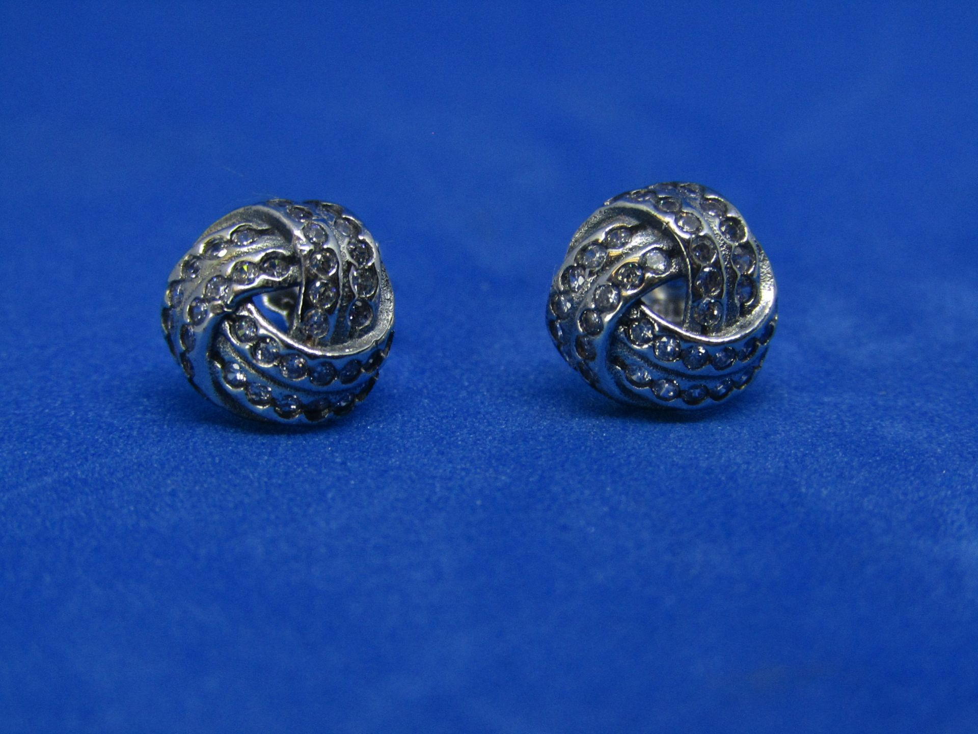 Pandora Earrings, new with presentation bag.