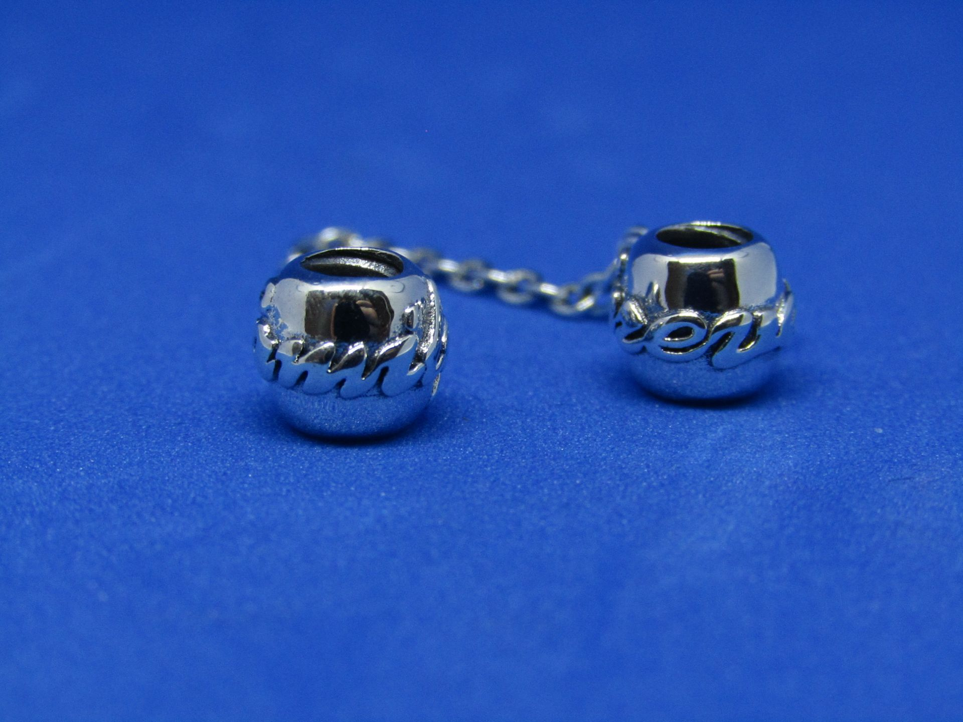 Pandora Safety chain linked charms, new with presentation bag.