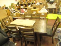 Whaslen 7 piece extending dining set, ex display, has a couple of scratches on the table top,