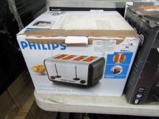 Philips 4 slice toaster, tested working and boxed.