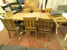 Large Costco 9 Piece dining table set, includes 8 chairs (one dismantled and unchecked) and a