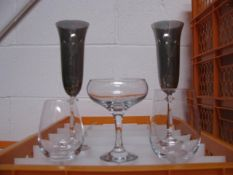 Quantity of various style champagne flutes