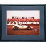 Signed and framed photograph of Stirling Moss at Goodwood, 23rd April, 1962