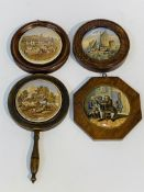 Four 19th Century pot lids in wooden frames