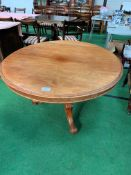 Mahogany circular tilt top table.