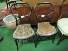 2 ebonised and mother of pearl decorated cane seat bedroom chairs.