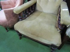 Victorian / Edwardian brown upholstered armchair on casters.