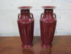 A pair of Sang de Boeuf Vases