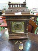 Oak cased mantel clock by W&H Son.