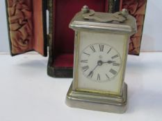 Miniature silver cased carriage clock by Ansonia Clock Co. New York in original leather-covered case