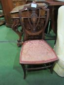 Inlaid mahogany shield back nursing chair.